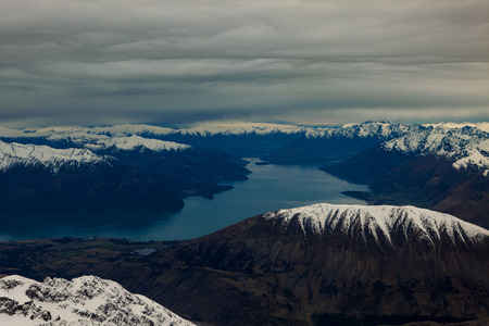 aerial view of high snowcaped mountain in queenstown south island new zealand