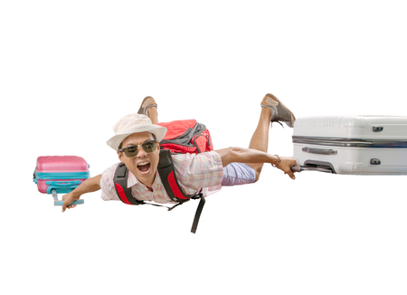 asian traveling man flying with luggage bag crazy face isolated white background Foto de archivo