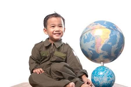 asian children wearing military pilot suit toothy smiling face with world globe model isolated white background