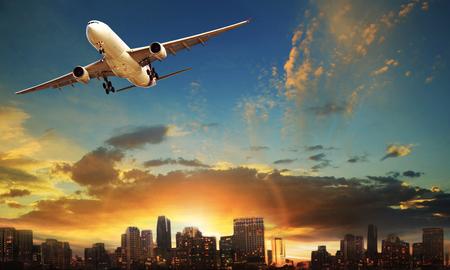 passenger plane departure against beautiful city building background Stok Fotoğraf