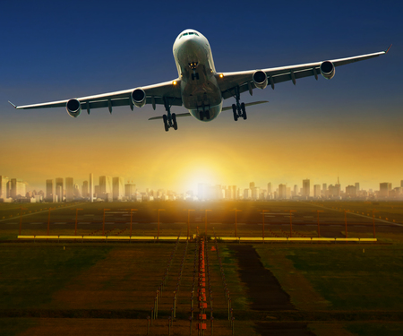 jet plane taking off from airport runway for traveling and logistic theme Stock Photo