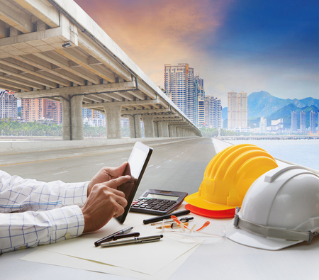 civil engineer working table and urban building with infra structure development