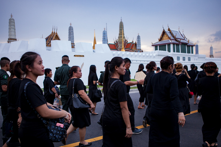 BANGKOK THAILAND - OCTOBER 5,2017 : thai mourners people wearing black clothes on last day of respect to their beloved king bhumibol adulyadejat at grand palace