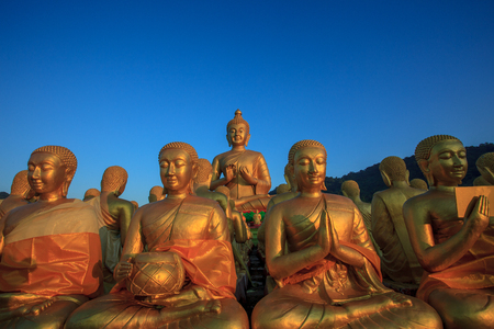 buddha statue against clear blue sky in thailand temple