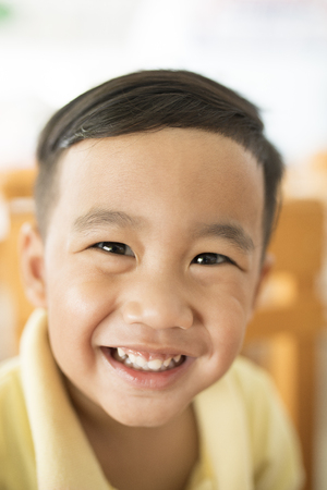 toothy smiling face happiness emotion of asian children shallow depth of field 版權商用圖片