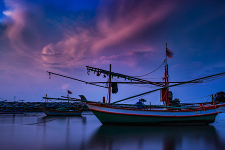 beautiful long exposure photography at dawn of fishery boat in thailand