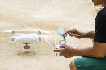 man playing quad copter drone for taking aerial  photography