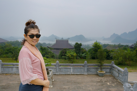 asian woman toothy smiling face standing in bai dinh temple ninh binh province vietnam