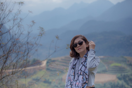 portrait head shot of asian woman and mountain scene in sapa vietnam Stock Photo