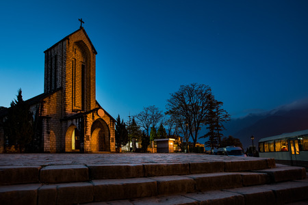 ancient stone church of sapa with blue night sky most popular traveling destination in sapa norhtern of vietnam Stock Photo