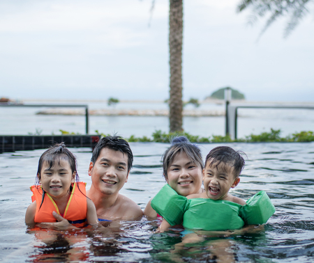 asian family happiness in sport water pool