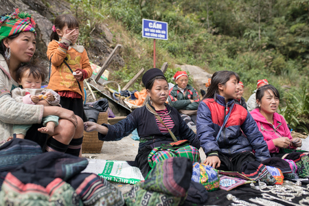 LAO CAI SAPA VIETNAM -NOV5,2017 : northern vietname hill tribe sitting beside road for selling hand made product in sapa town most popular traveling destination in northern of vietnam