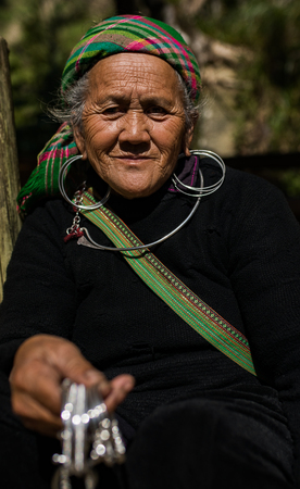 LAO CAI SAPA -VIETNAM - NOV4,2017 : close up face of unidentified old woman of sapa hill tribe selling woman silver accessories  Editorial