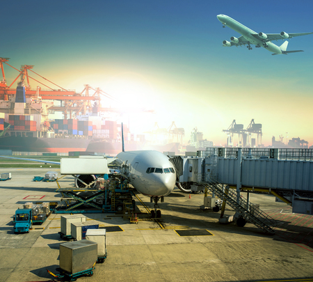 cargo plane loading commercial goods against large logistic ,shipping port background