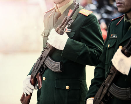 vietnam solder in long rifle weapon marching outdoor Reklamní fotografie