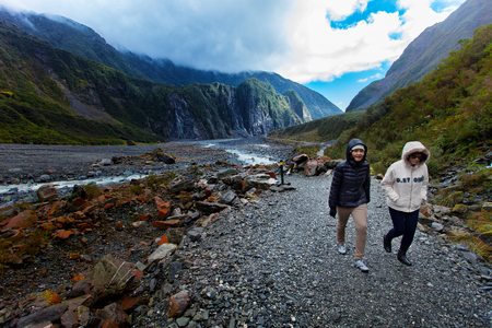 FRANZ JOSEF GLACIER NEW ZEALAND - SEP4,2015 : unidentified tourist trekking in franz josef glacier natural trail ,franz josef is most popular traveling destination in west coast of south island of new zealand