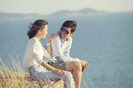 couples of younger asian man and woman relaxing with happiness on vacation time