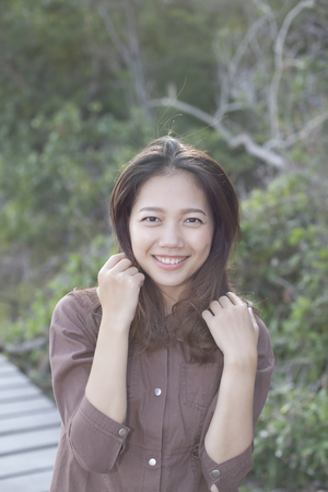 portrait of asian younger woman toothy smiling face
