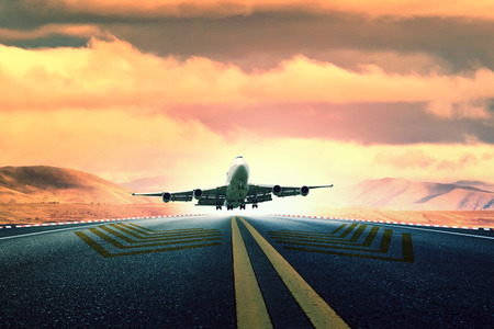 large passenger plane take off from airport runway