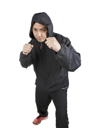 asian boxer man wearing black hood jacket pose boxing acting isolated white background