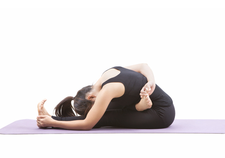 woman playing yoga on purple mat isolated white background