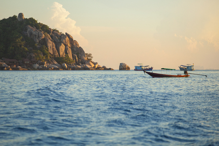 long tail boat floating over blue sea at koh nang yuan and koh tao island most popular traveling destination in southern of thailand
