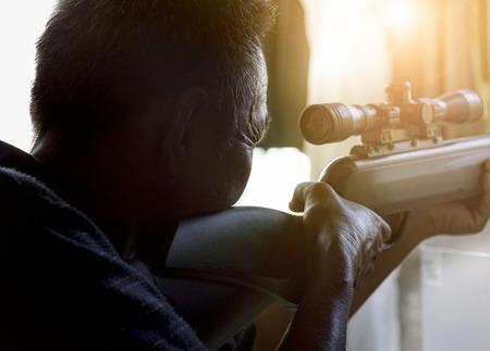 man approaching to shoot long rifle weapon  Stock Photo