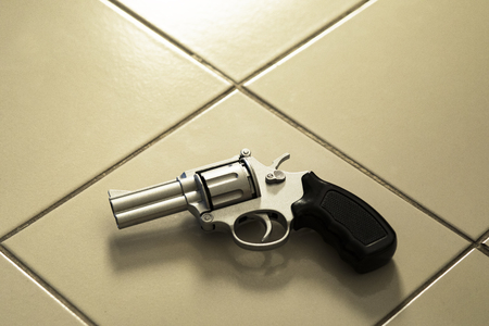 revolver gun laying on room floor Banco de Imagens - 98362031