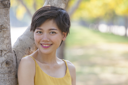 beautiful asian younger woman toothy smiling face happiness emotion