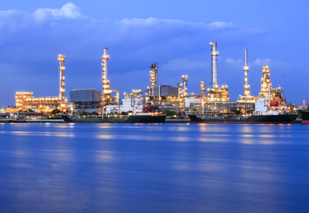 ship port and oil refinery plant with blue river on twilight time