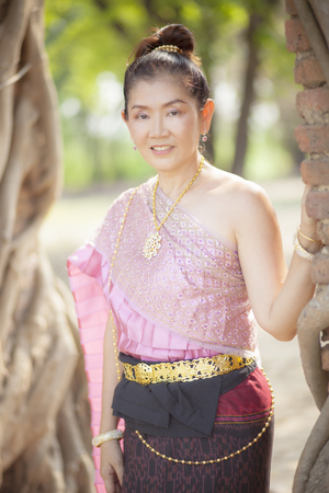 beautiful asian woman wearing thai tradition clothes toothy smiling face in ayutthaya Banco de Imagens