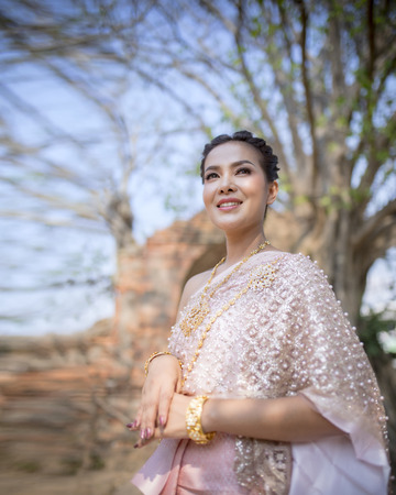 portrait beautiful thai woman wearing thai tradition clothes dress standing in old temple of ayutthaya