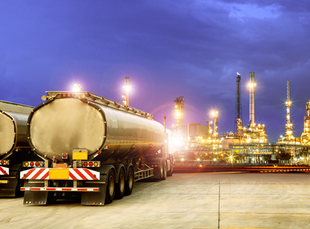 oil container truck and beautiful lighting of oil refinery plant  Stock Photo