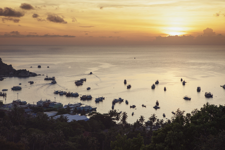 sunset sky at koh  tao harbor most popular traveling destination in surathani southern of thailand 版權商用圖片