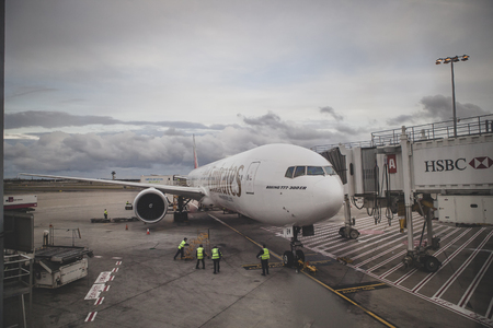 SYDNEY AUSTRALIA - SEP 6,2015 : technician team checking boeing 777-300 er of emirates airline  in park hole of Sydney Kingsford Smith International Airport  에디토리얼