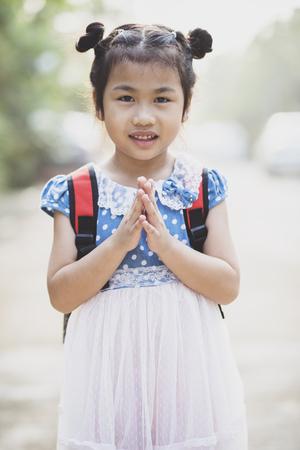 thai children posting sawasdee acting toothy smiling face outdoor Stock fotó