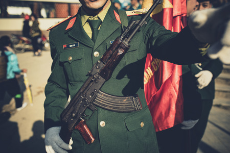 vietmanese solding marching with long rifle gun