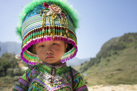 SAPA VIETNAM - NOV4,2017 : unidentified children wearing decorated tradition clothes hat of hill tribe in sapa town northern of vietnam ,sapa one of most popular traveling destination in north of vietnam