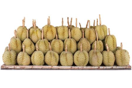 durian fruit arranged on wood shelf isolated white background Stock Photo