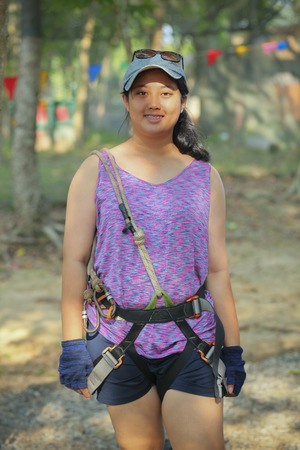 asian teenager wearing safety harness suit preparing for playing adventure base 스톡 콘텐츠 - 101305331