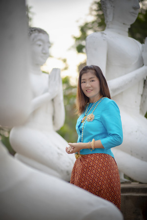 asian woman wearing thai tradition clothes standing in ayutthaya world heritage site of unesco thailand Фото со стока - 101548410