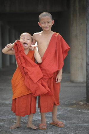 PATTAYA THAILAND - APRIL16,2018 : unidentified of two buddhist novice playing with happiness emotion in thai buddhist temple ,most of thai boy must be a novice once in a life time Editöryel