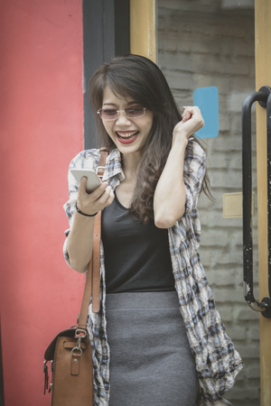 younger woman happiness emotion reading message on smartphone