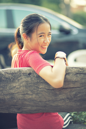 asian teenager toothy smiling face with relaxing emotion