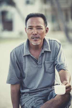 asian senior man and coffee cup in hand Stock Photo