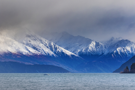 foggy and cloudy climate of lake wanaka most popular traveling destinationa in new zealand