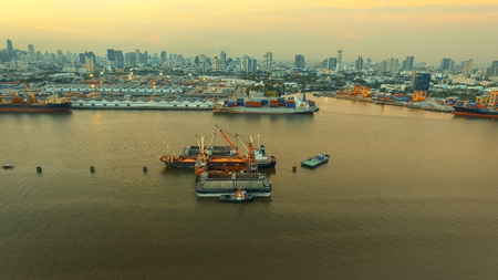 aerial view of klong tuey port and container ship loading rice paddy over chaopraya river heart of bangkok thailand capital