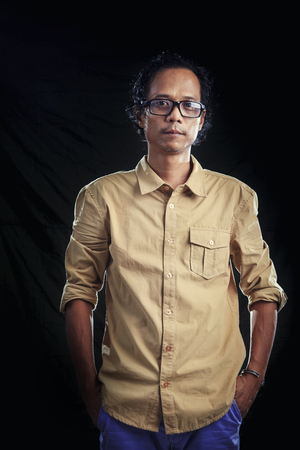 photogrpahy with studio light of asian man wearing brown shirt and sun glasses in studio Stock Photo