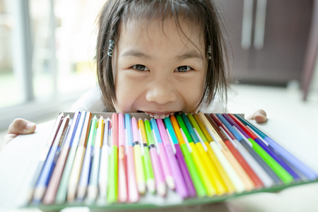 kidding asian children and tray of color pencil Stock Photo - 104244658