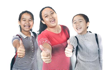 asian teenager raising thumb sign like on white background Stockfoto
